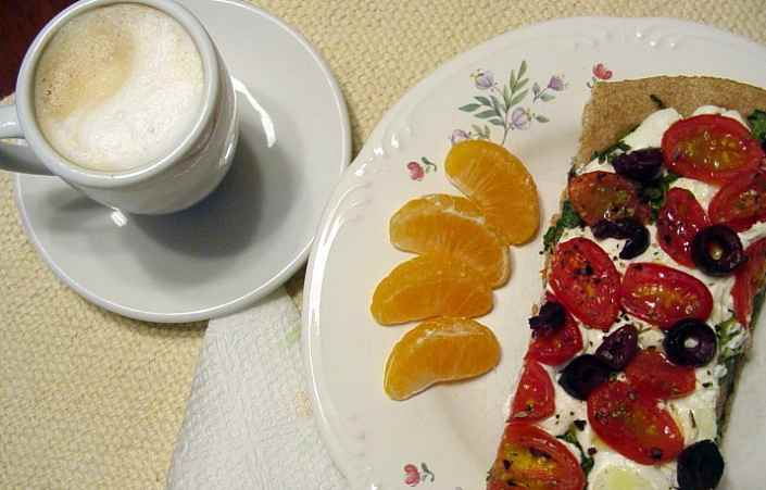 Goat Cheese, Black Olive And Arugula Pizza With Mandarin Orange Slices And Cappucino