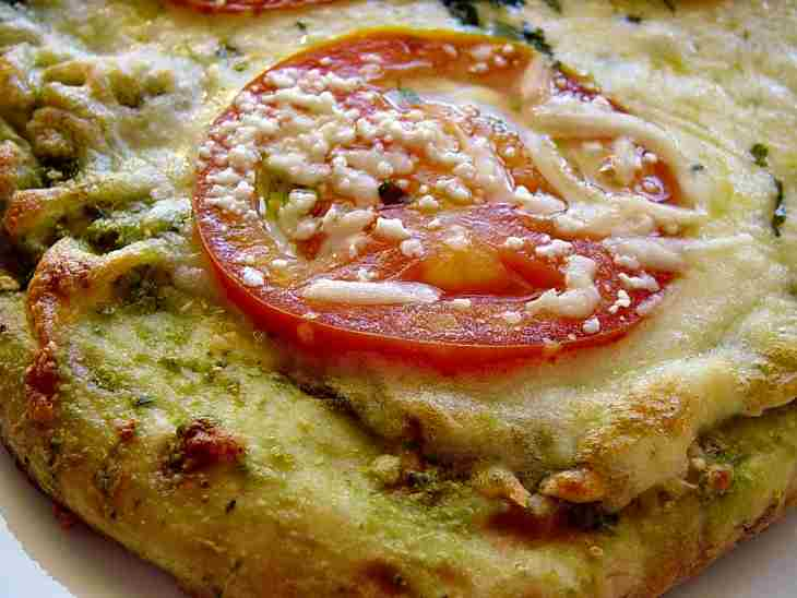 Delicious Cheesy Pizza With Herbs And Fresh Tomatoes
